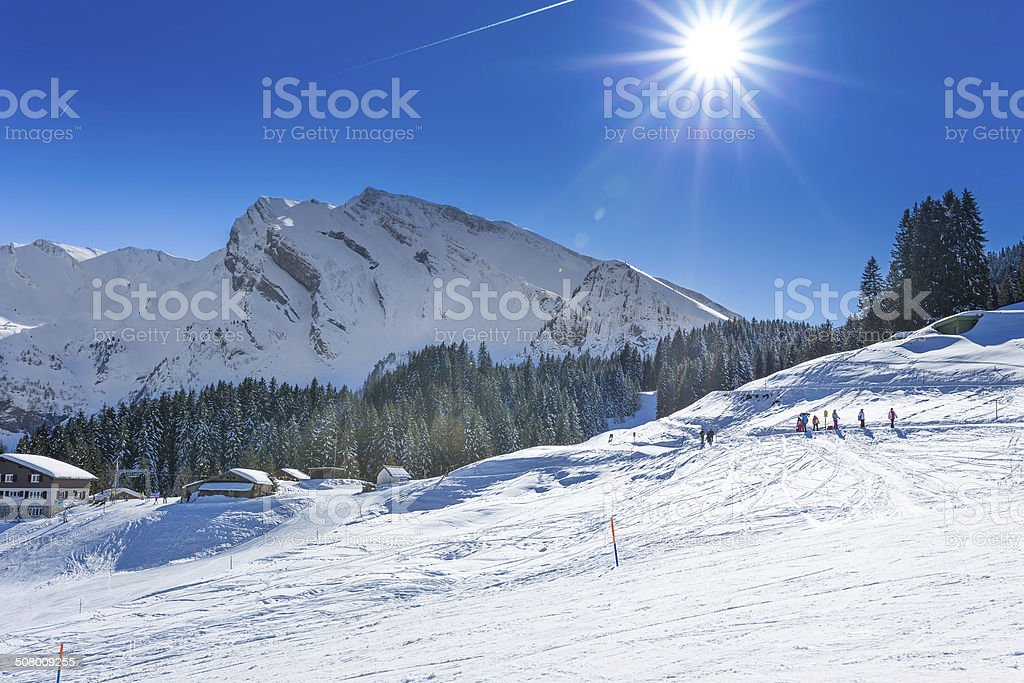 Skiers and hikers in Swiss Alps, Central Switzerland stock photo