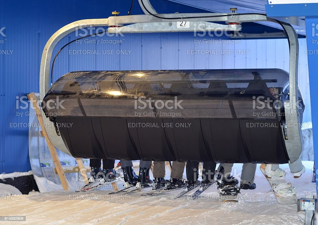 Skiers and snowboarders are expected to rise in gondola stock photo