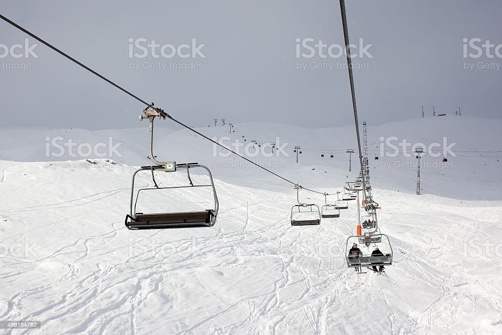 Skiers and snowboarders in the lift at the Gudauri stock photo