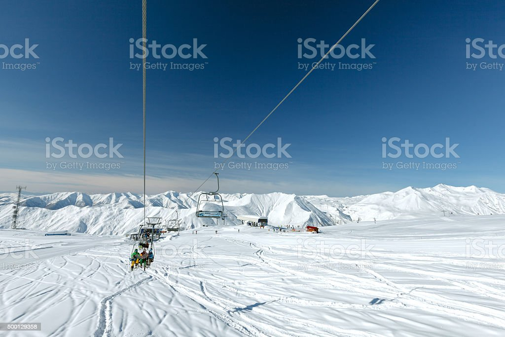 Skiers and snowboarders in the lift at the Gudauri snow stock photo