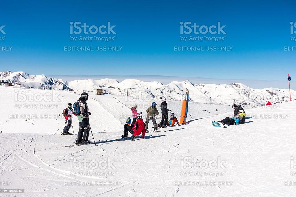 skiers andorra snowboarders clear sky snow ski slope stock photo