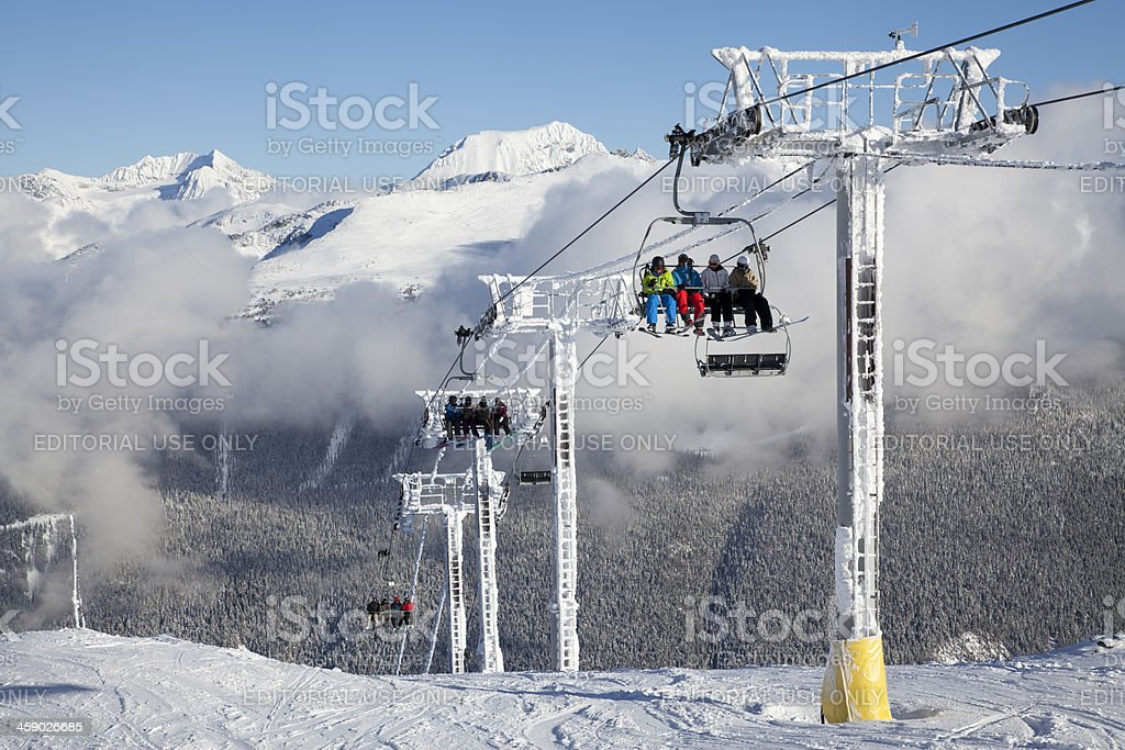 Skiers Arriving at the Top of Harmony Chair. stock photo