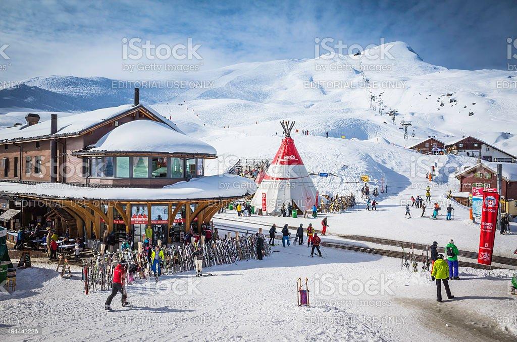 Skiers at Alpine ski resort high on snowy mountain Switzerland stock photo