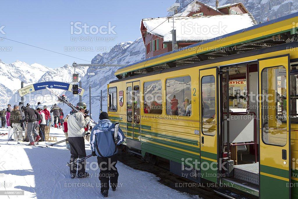 Skiers at Kleine Scheidegg railway station, Switzerland royalty-free stock photo