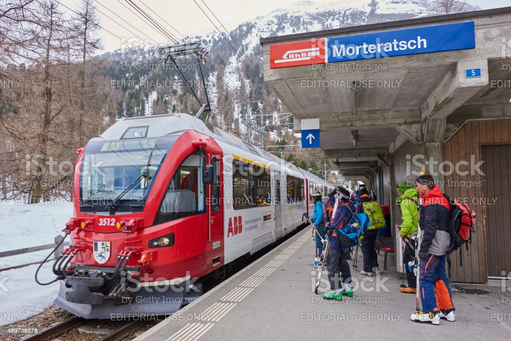 Skiers at Morteratsch Station stock photo