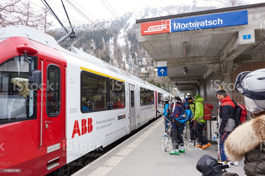 Skiers at Morteratsch Station stock photo
