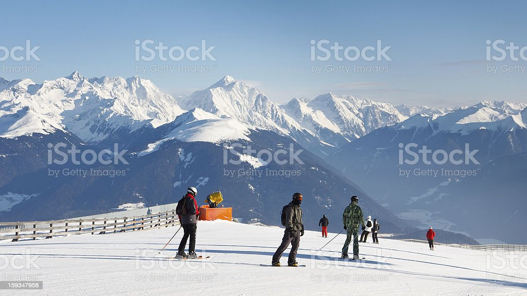 Skiers Enjoy Fantastic Alpine Panorama royalty-free stock photo