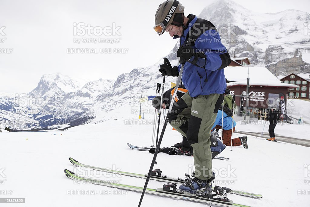 Skiers getting ready in Alps royalty-free stock photo