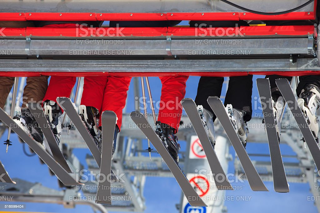 skiers in a ski lift at Berwang stock photo