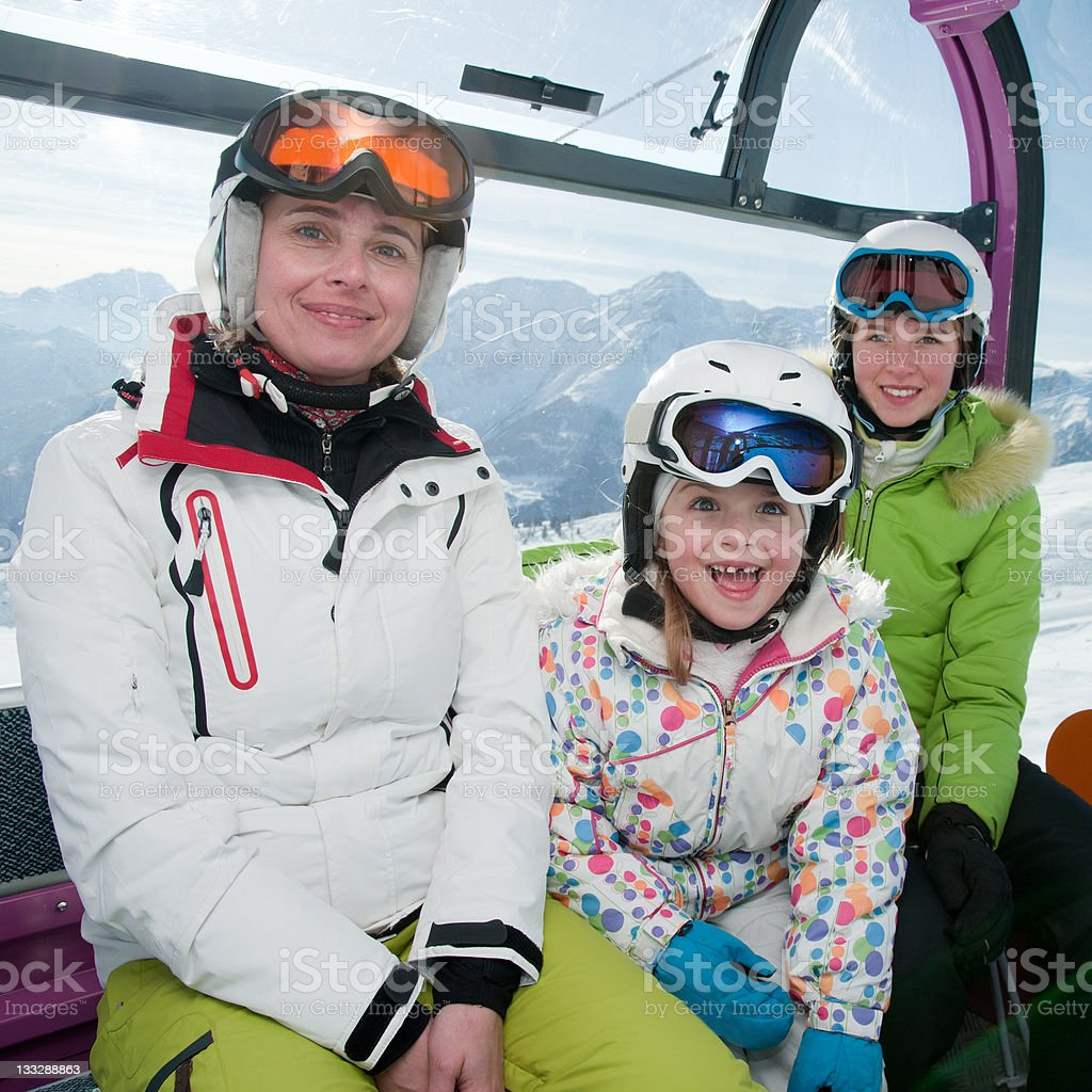 Skiers in cable car royalty-free stock photo