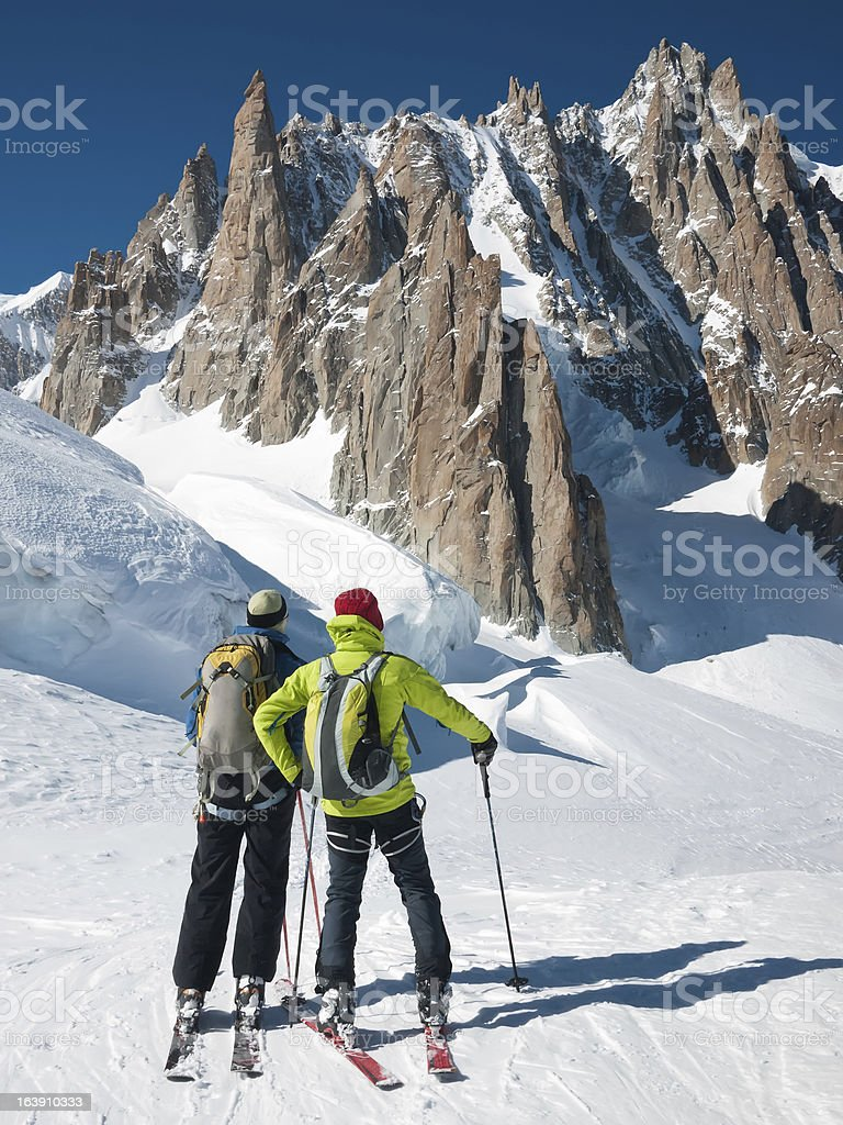 Skiers in front of Mont Blanc royalty-free stock photo