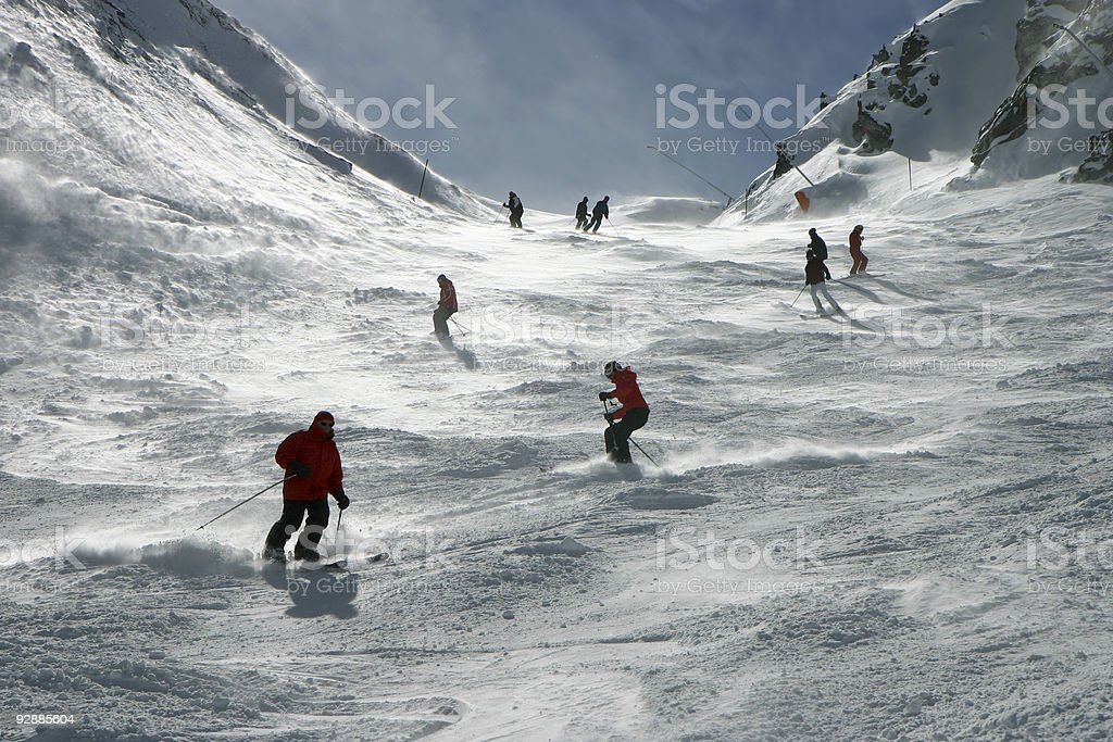 Skiers in the Alps stock photo