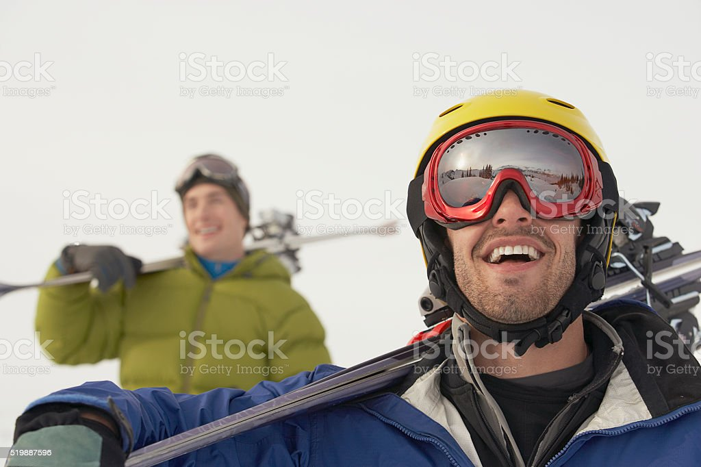 Skiers in the mountains stock photo