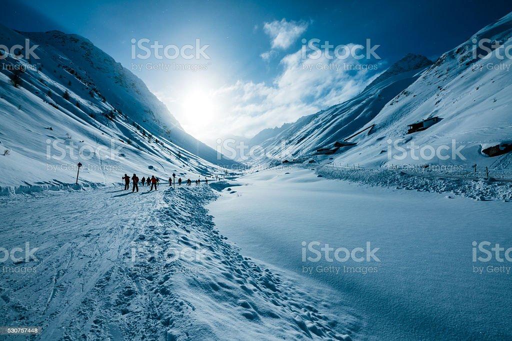 Skiers in valley of ski resort Soelden, Tirol, Austria stock photo