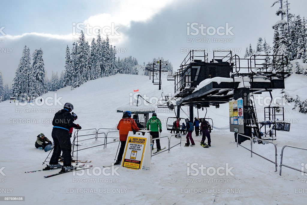 Skiers Load Chairlift at Mt Baker Ski Area Washington State stock photo