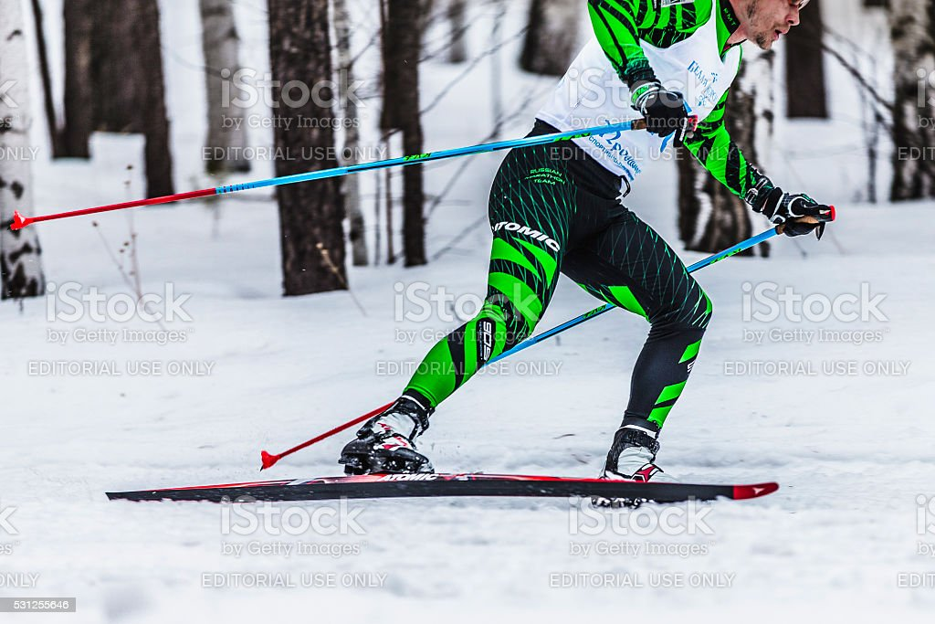 skiers male athletes running through woods side view stock photo