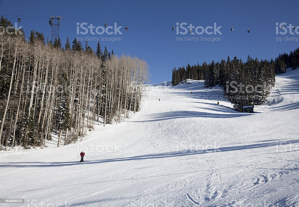 Skiers on a Wide Open Slope royalty-free stock photo