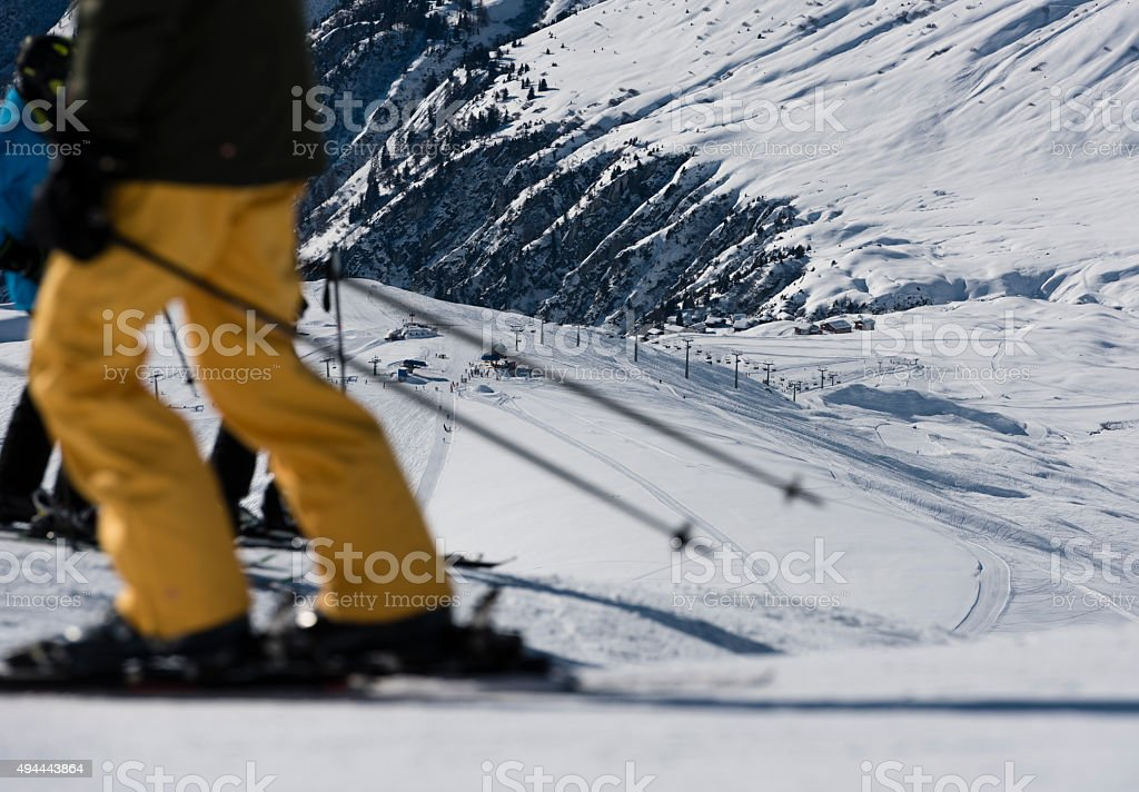 Skiers on crowded ski piste in winter sports resort stock photo