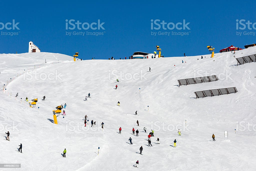 Skiers on crowded ski slope stock photo