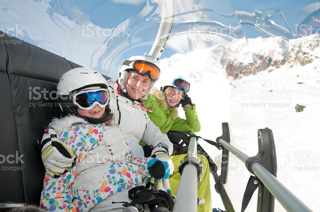 Skiers on ski lift royalty-free stock photo