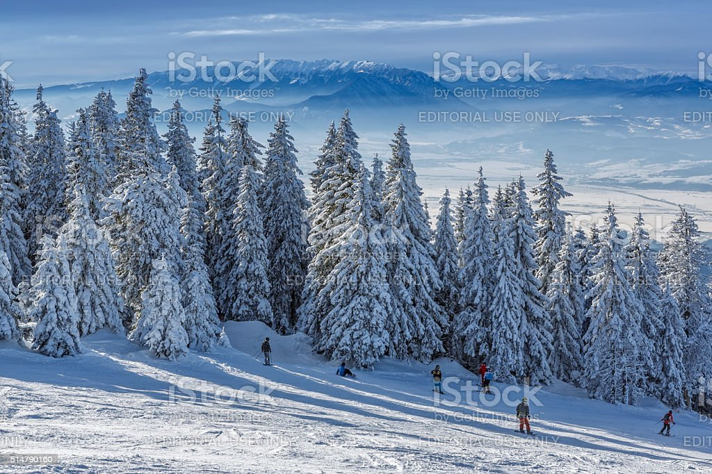 Skiers on ski slope stock photo
