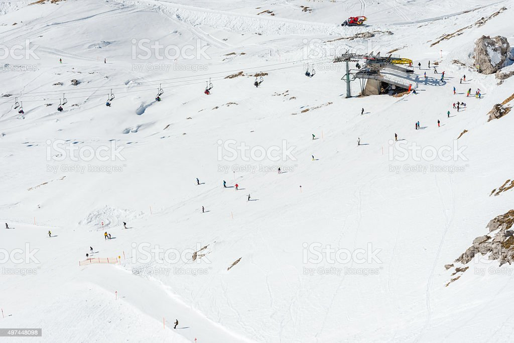 Skiers on slope skiing stock photo