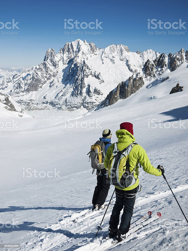 Skiers on the big glacier of Vallee Blanche. stock photo