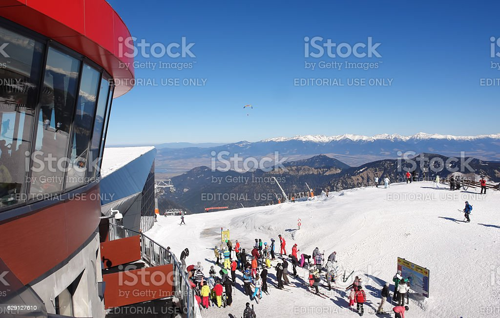 Skiers on the cable car station Chopok stock photo