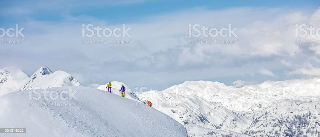 Skiers on top of hill stock photo