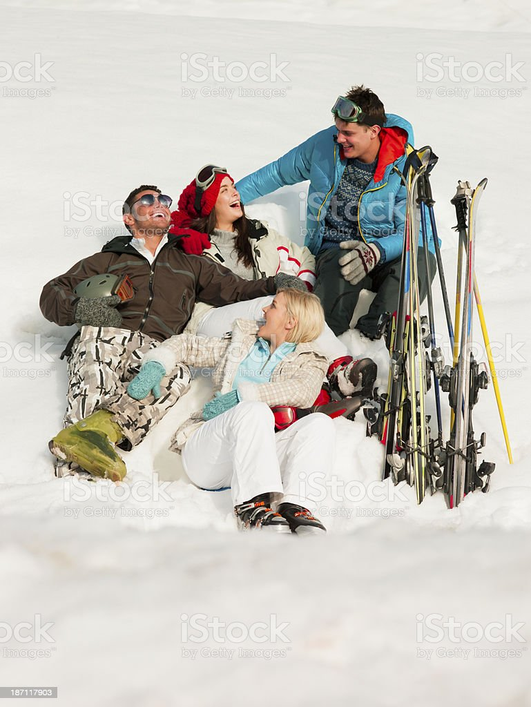 Skiers Sitting In Snow stock photo