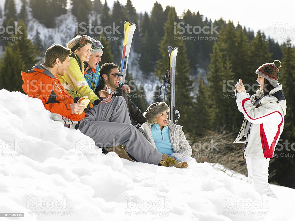 Skiers Sitting In Snow Posing For A Photo royalty-free stock photo