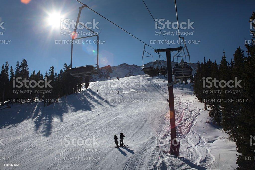 Skiers ski slopes and people riding lift Loveland Resort Colorado stock photo