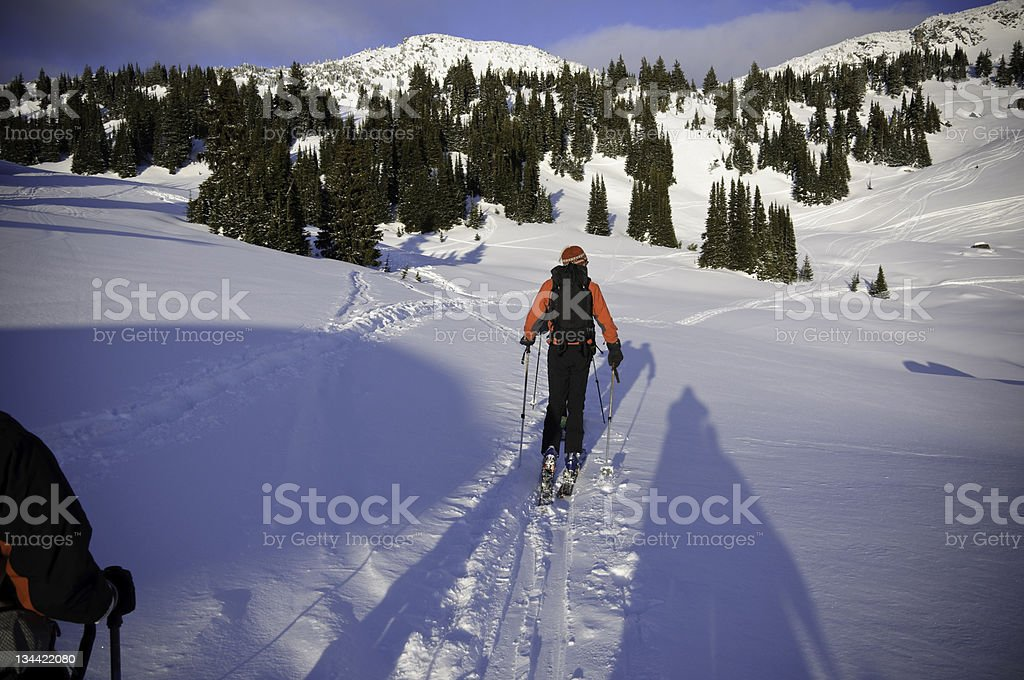 Skiers SKi Touring in the Selkirk Mountains Canada royalty-free stock photo