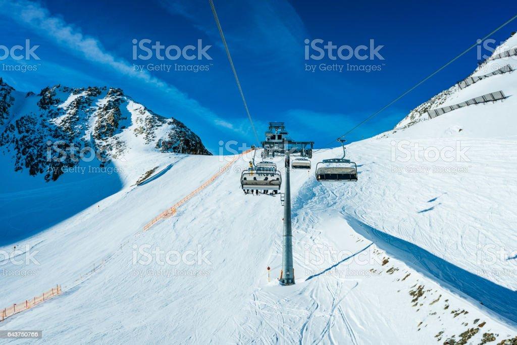 Skiers skiing at winter ski resort Soelden stock photo
