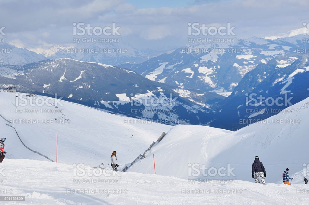 Skiers skiing on the piste in the Alps stock photo