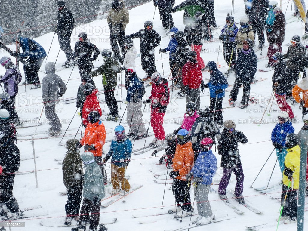 Skiers Waiting in a Chair Lift Line stock photo