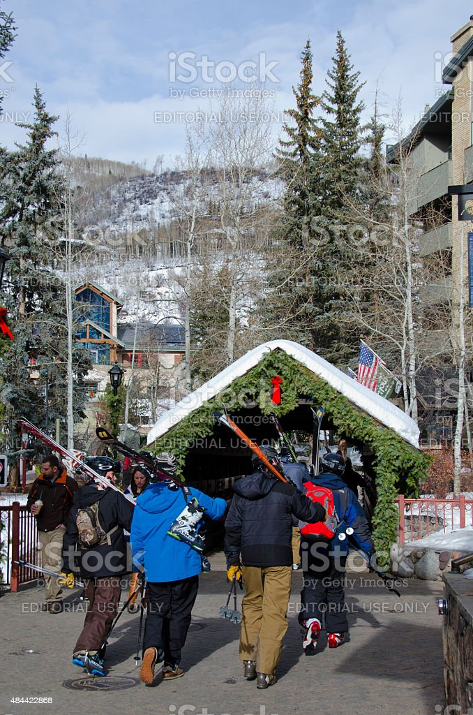 Skiers Walk To Vail Covered Bridge stock photo