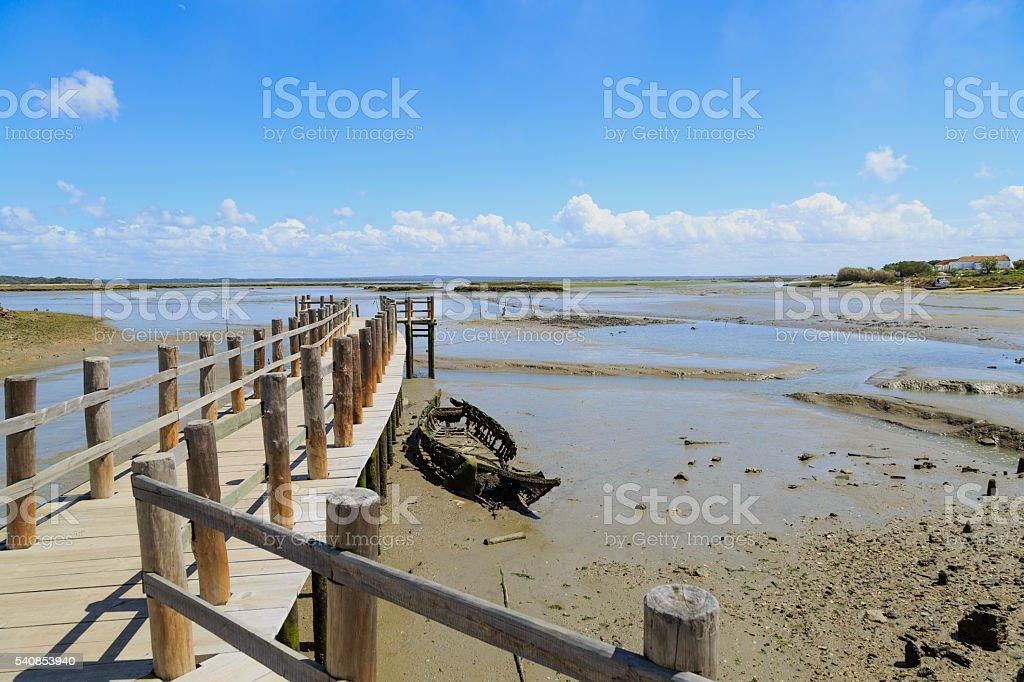 skiff wreck in ebb-tide stock photo