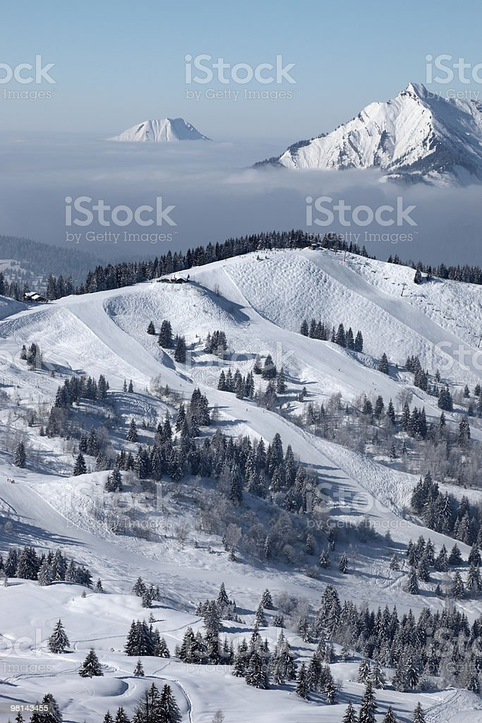 Skifield above the clouds stock photo