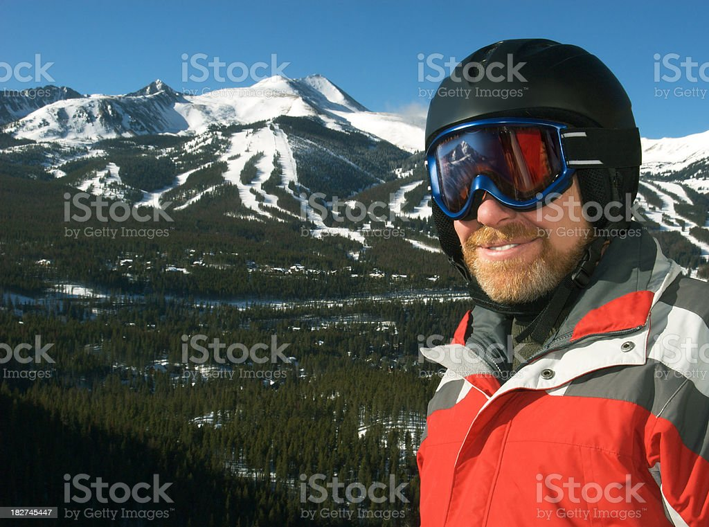 Skiier Looking Through Goggles to Ski Area stock photo