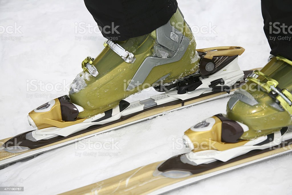 Skiier putting on skis stock photo