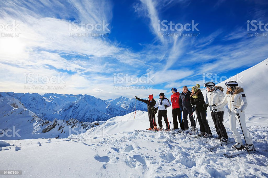 Skiiers group  enjoying sunny day on the top    Snow mountain stock photo