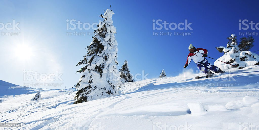 Skiing against clear blue sky. royalty-free stock photo