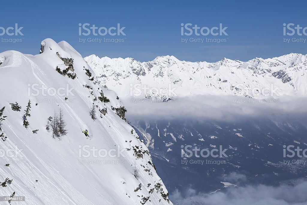 Skiing aggressively in the Alps backcountry royalty-free stock photo