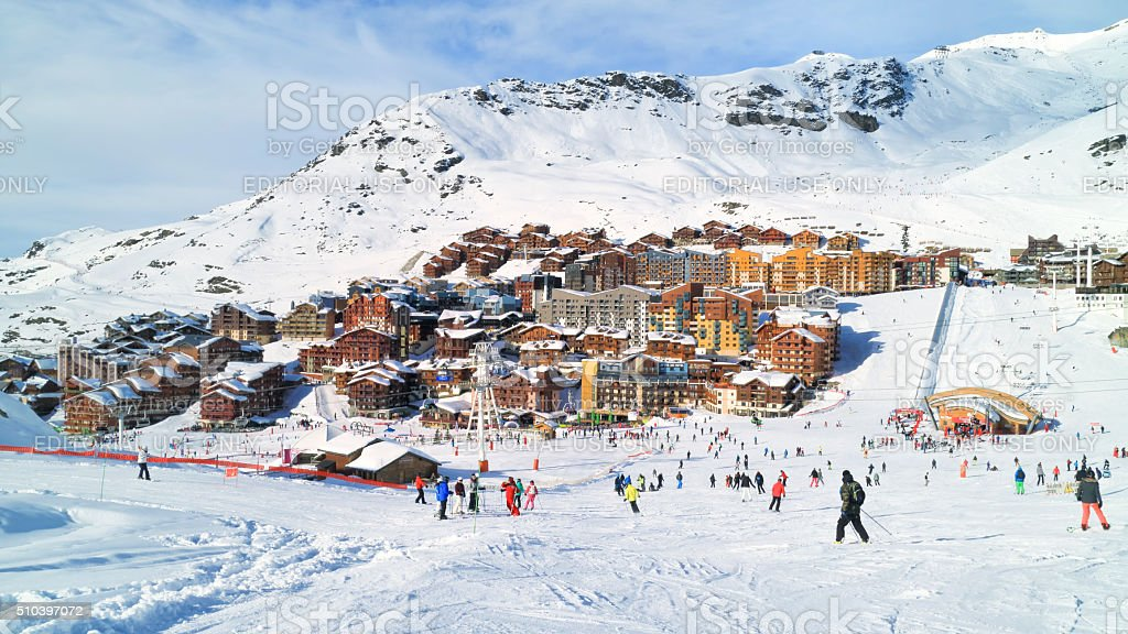 Skiing and snowboarding in French alpine winter resort stock photo