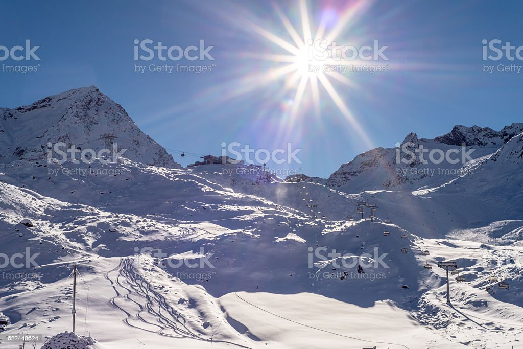 Skiing and Snowboarding in the winterly Stubai Alps stock photo