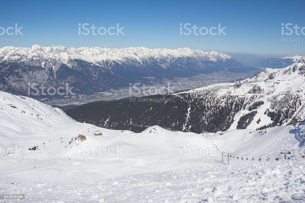 Skiing At Axamer Lizum With View To Innsbruck Tyrol Austria stock photo