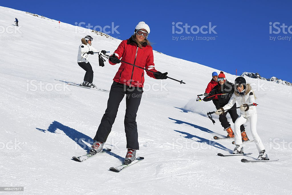 Skiing class on the mountain slope stock photo
