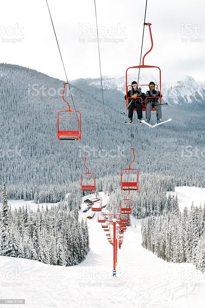 skiing couple on chairlift royalty-free stock photo