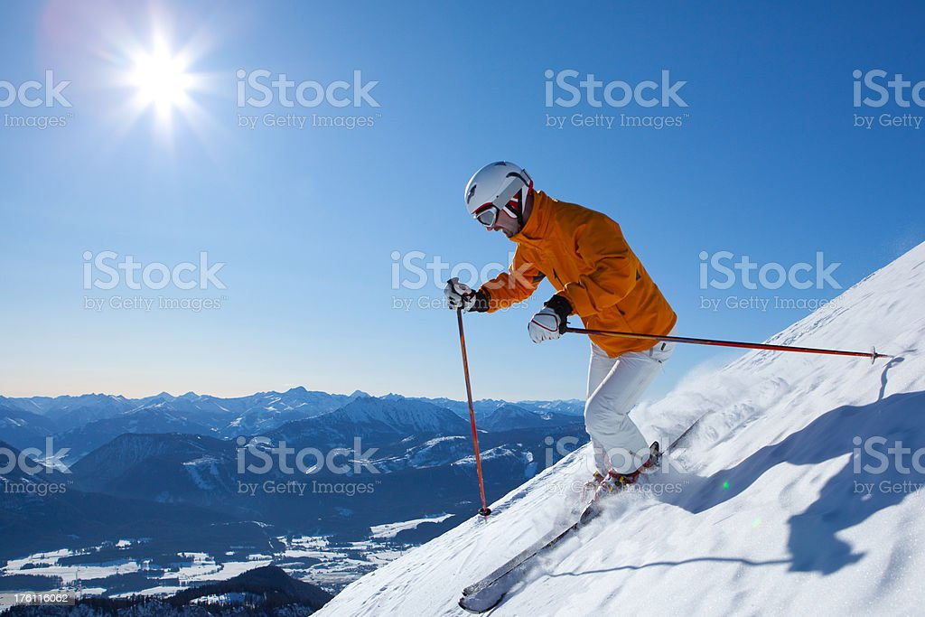 skiing down steep mountain royalty-free stock photo